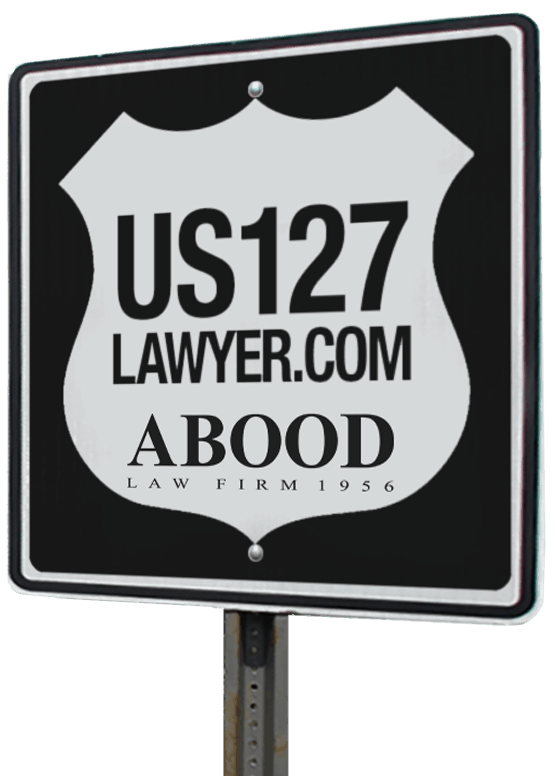 Highway sign with US127Lawyer.com website address and Abood Law Firm Logo